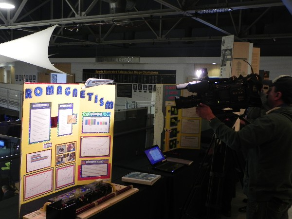 In April, the media is invited to view student science fair projects at a competition.