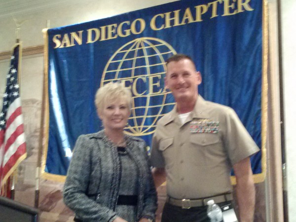 In September, Shirley Adams, chapter vice president for programs, thanks Col. Snyder for his speech.