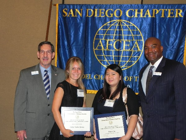 SAN DIEGO—Chapter Education Chair Pat Kelly (far l) and Chapter President Benito Hobson (far r) present scholarships to Ashley Sprigg (center l) and Linjue Cao (center r) in June.