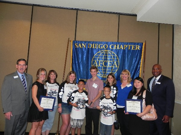 SAN DIEGO—In June, Kelly (l) and Hobson, (r) greet scholarship winners and kids from the science fair.