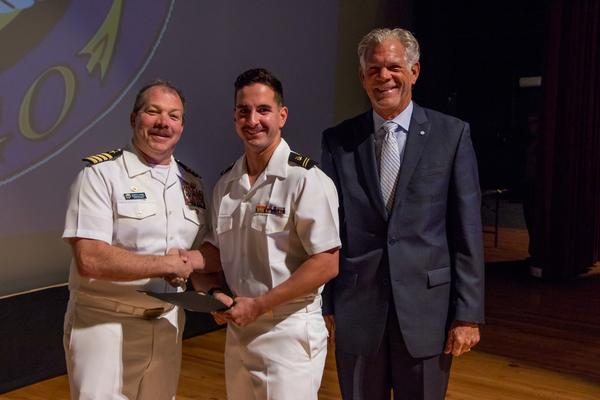 Capt. Dave Grundies, USN (Ret.), chapter chairman of the board (r), and Capt. Edwin Kaiser, USN, commanding officer, Naval ROTC San Diego Consortium (l), present the AFCEA ROTC Honor Award in April to Midshipman Mitchel DiLorenzo, USN.