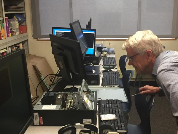 Chapter Member Tom Howard installs a refurbished computer at Hilltop Elementary School in Chula Vista, California, in December.