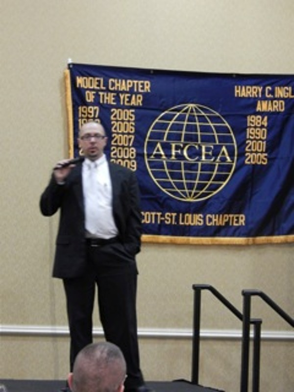 Kristopher Bleich, director of forensic services for Speartip, addresses the chapter in October.