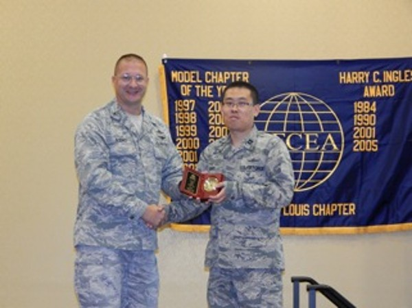 In October, Col. David Bosko, USAF (l), chapter president, presents the AFCEAN of the Month Award to Capt. Jichul Song, USAF.