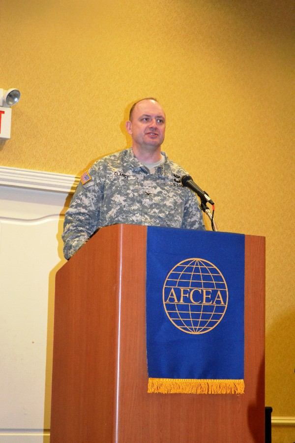 Col. Tom Clancy, USA, chief, U.S. Transportation Command Joint Cyber Center, presents three