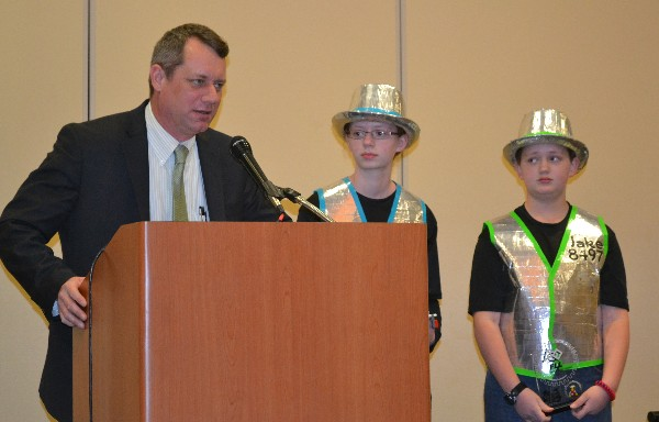 In February, Jeff Gulick (l), Da Ex Bots team coach, along with team leads Jenna and Jake Gulick, reports on the successful 27-team competition and thanks the chapter for its $1,000 STEM grant enabling the rescheduling of the Southern IL FIRST Lego League tournament due to weather cancellation.
