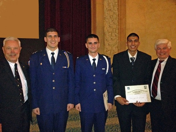 Bob Moorhead (r), chapter president, and Robert Landgraf (l) present scholarships to Air Force ROTC cadets Frank Rosette, Calvin Craig and Harman Purewal from Detachment 045 at San Jose State University in December.