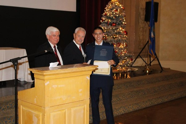 At the December Air Force ROTC Detachment 045 Fall Dining-Out, Bob Moorhead (l), chapter president, and Bob Landgraf, former regional vice president (c), present Steven Wong a scholarship check and certificate.