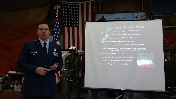 Lt. Col. Enrique Oti, USAF, Stanford University fellow, discusses the different types of cyberattacks at a May meeting.