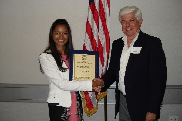 In August, Reema Prasad accepts a certificate of appreciation from Morehead for her presentation on Internet security.