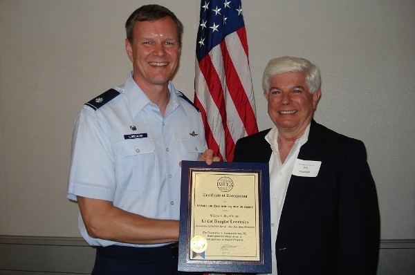 Morehead presents an award to Lt. Col. Douglas Lomsdalen, USAF, in August for his efforts within the chapter to streamline chapter communications and event registration.