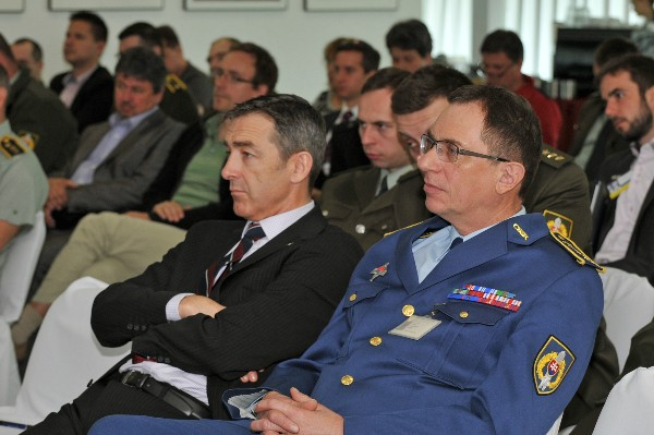 In May, Chris Stace, senior project manager, European Defence Agency (l) and Col. Ivan Ilavsky, Ministry of Defence Slovakia, listen to a speaker during the Defence Fair-IDEB 2014.