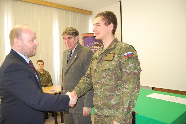 Jir�sek shakes hand with Pvt. Jozef Kostelansk, president of the new student club, while Ďulk looks on.