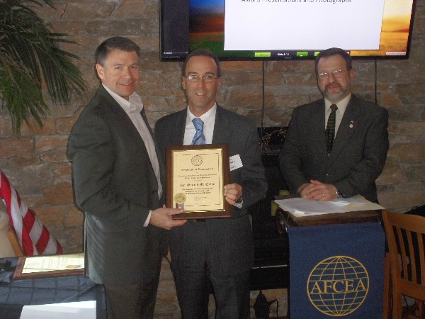 In February, Shannon Sullivan (l), AFCEA regional vice president, and Lee Rossetti (r), chapter president, present a special award to Eric S. Spigel on behalf of Dr. Gerard M. Exley from the Naval Undersea Warfare Center.