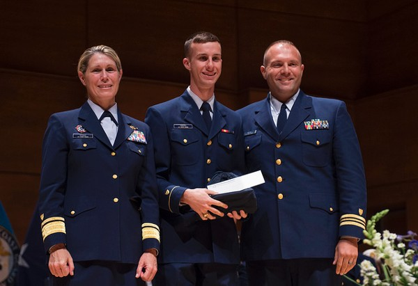 Lt. Cmdr. Steven Myers, USCG, chapter vice president, Young AFCEANs (r), presents an award to U.S. Coast Guard Academy Cadet Daniel Siders (c) during a May ceremony alongside Rear Adm. Sandra L. Stosz, USCG, academy superintendent.