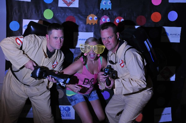 Megan Ham, Young AFCEAN chapter chairperson, joins fellow �Ghostbusters� Dave Ambrose (l) and Chris Terio from APEX Systems during the chapter�s 80s-themed fundraiser in July.
