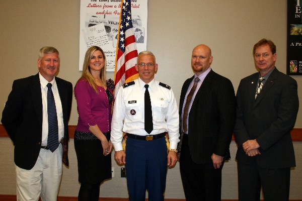Gathering at the February luncheon are (l-r) John Jarvis, chapter vice president; Pam Plesz, secretary; Col. Charles Grindle, USA, faculty instructor at the U.S. Army War College; John Snider, chapter president; and Patrick O'Brien, treasurer.