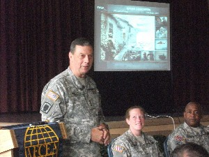 Lt. Gen. Carroll F. Pollett, USA, director, Defense Information Systems Agency, speaks to the chapter in August.