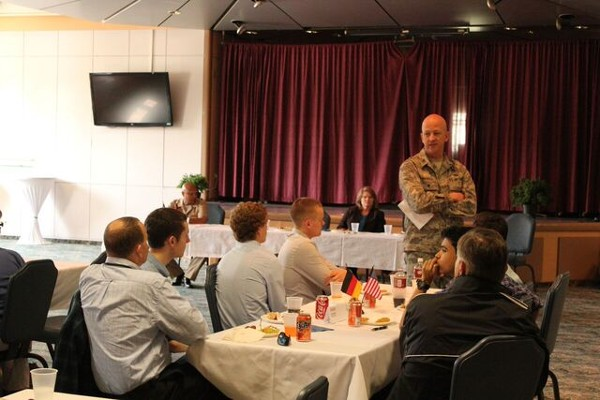 Col. Jeremiah Boenisch, USAF, Special Operations Command Europe (SOCEUR) J-6 director, addresses scholarship recipients and luncheon attendees in May.
