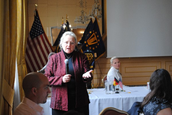 Cindy Moran, Director of the Network Services Directorate at the Defense Information Systems Agency, addresses a full house at the Swabian Special Events Center in April.