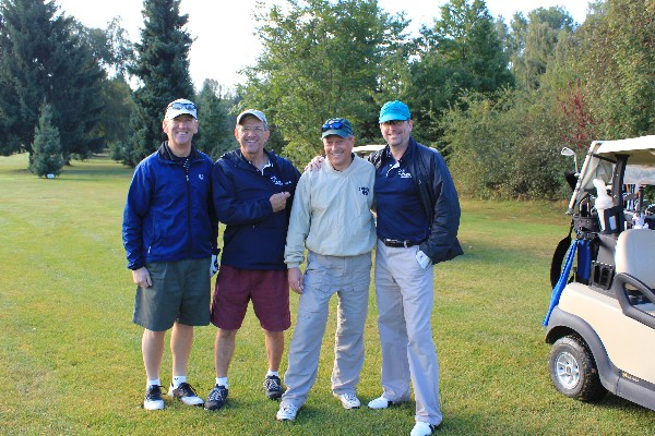 Jim Condon, vice president, International Division, DRS, pauses with DRS teammates between holes at the chapter's Golf Classic in September, which raised funds for education.
