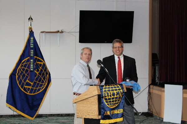 Roger Carpenter (l), chapter president presents Timothy Bootle, infrastructure senior manager for outside the contiguous United States, Space and Naval Warfare Systems Command, Systems Center Atlantic, with a chapter coin and golf shirt as tokens of appreciation following his presentation to the chapter in November.