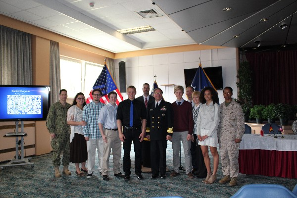 Gathering at the May scholarship presentation are (l-r) Cmdr. and Mrs. Williams with their son Diego Williams, scholarship recipient; Matthew Watson, scholarship recipient; Dyan Rehwaldt, scholarship recipient; Sam Milford, chapter vice president for programs; Vice Adm. Charles Martoglio, USN, deputy commander, U.S. European Command, guest speaker; Olaf Bergeson, scholarship recipient, with his parents; and Morgan Mahlock, scholarship recipient, with her mother, Lt. Col. Mahlock, USMC.