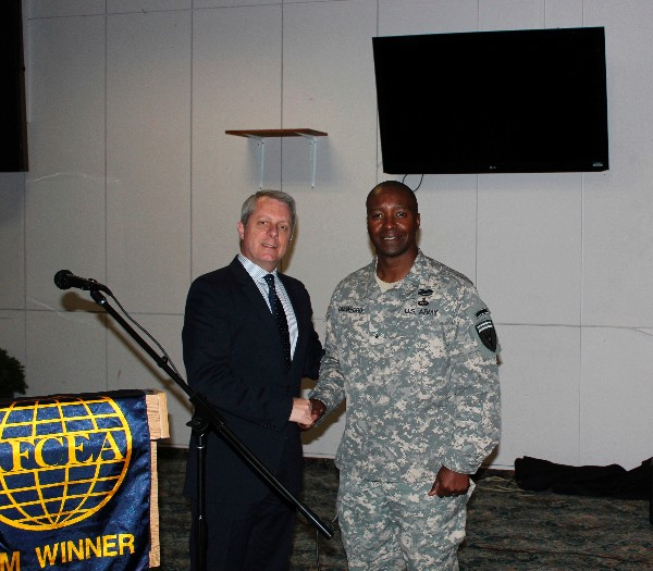 Roger Carpenter (l), chapter president, presents Gen. Crawford with a chapter coin and plaque to thank him for speaking at the chapter's October luncheon.