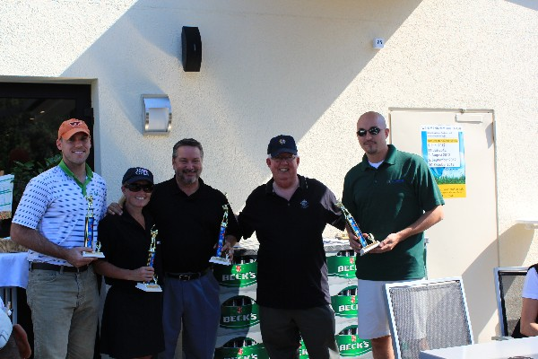 At the scholarship golf tournament in September, Dr. Joe Page (2nd from r), chapter secretary, presents trophies to Kristen Gilbert, Keith Siville and fellow MC Dean teammates.