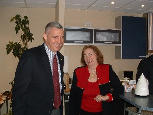Col. Mike Curry, USA, commander of the Defense Information Systems Agency-Europe and president of the Stuttgart Chapter, enjoys a light moment with Mary Ann Elliott, chairman of the board for Arrowhead Global Solutions, during the Stuttgart Chapter's professional development tour to the Raisting satellite communications facility.