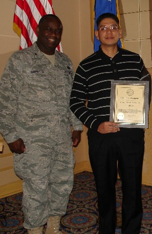 At the January chapter luncheon, Brig. Gen. Gregory L. Brundidge, USAF (l), director, European Command (EUCOM) J-6, presents an AFCEA Lifetime Membership certificate to Sgt. 1st Class Rodolfo Fuentes, USA.