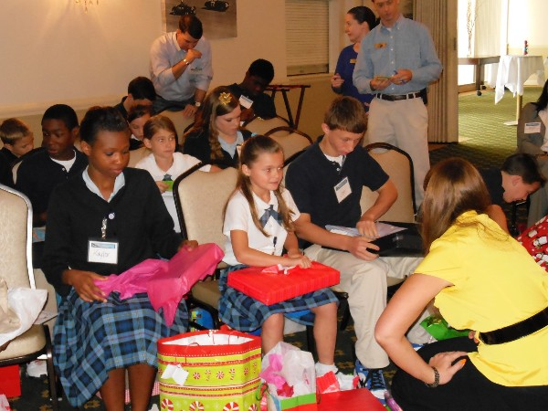 Children open up gifts at the Annual Hope Children's Home Christmas Celebration hosted by the chapter. The chapter's Young AFCEANs personally purchased the gifts, which were from each child's wish list.