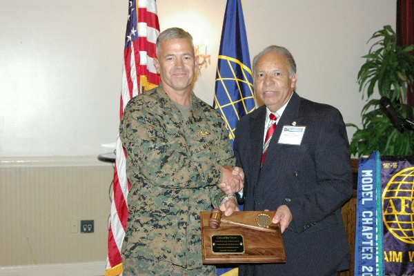 Col. Jim Turner, USMC, past chapter president, receives an award for his service to the chapter from Lou Ramos, regional vice president, in February.