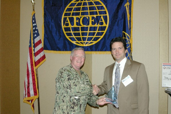 Capt. Slevin congratulates Mark Christensen, first vice president, in April for his overall dedication to the chapter.