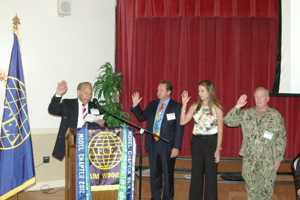 In February, Ramos (l) inducts new members of the chapter's board.
