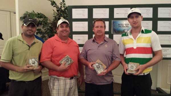 Golf tournament winners receive trophies during the August event, which raised funds for scholarships.