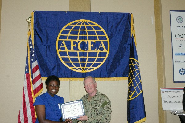 Capt. Slevin presents a STEM Scholarship certificate to a student recipient in April.