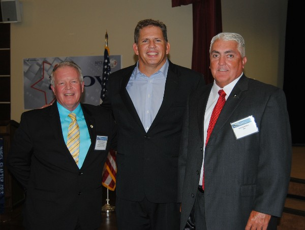 Capt. Gerry Slevin, USN (Ret.) (l), chapter first vice president, joins guest speaker James �Hondo� Geurts (c), acquisition executive, U.S. Special Operations Command, and Manning Bolchoz at the July chapter meeting.