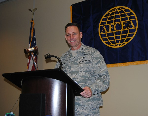 Col. Russ Smith, USAF, deputy J-6, U.S. Special Operations Command (USSOCOM), is installed as 2015 chapter president at the January luncheon.