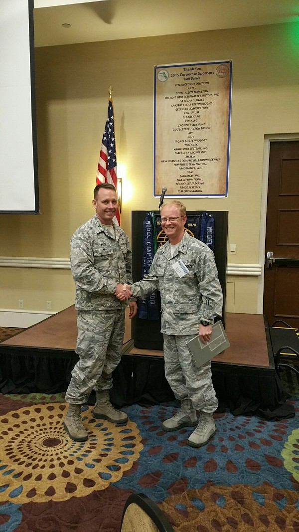 Col. Russell Smith, USAF, U.S. Special Operations Command (SOCOM) deputy J-6 and chapter president (l), thanks guest speaker Col. Matthew Atkins, USAF, chief, Intelligence Capabilities and Requirements Division (J-24), SOCOM, at the April luncheon.