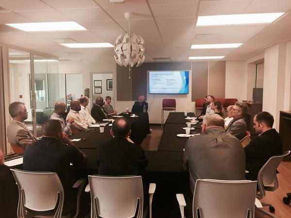 Small business chapter members discuss teaming strategies at the small business roundtable in November.
