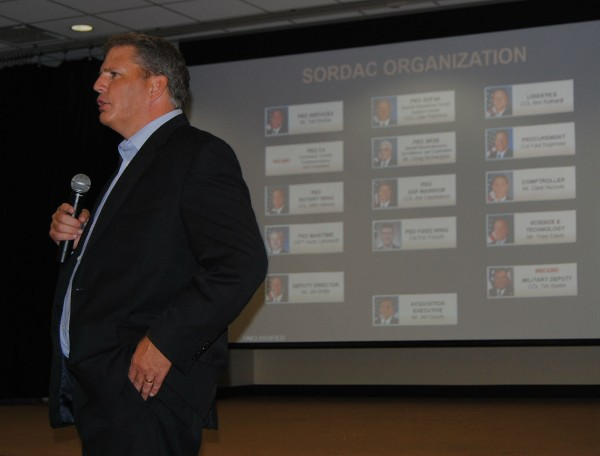 Geurts presents the chapter with information on the Program Executive offices in July.