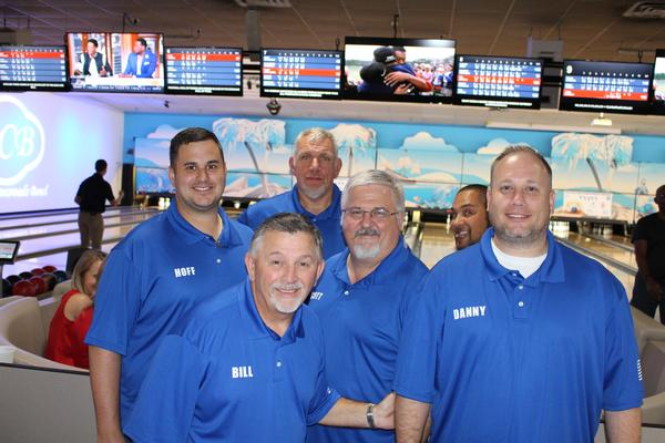 Team Jacobs celebrates its winning record at an April bowling fundraiser to support the chapter's Cyber Outreach Program.