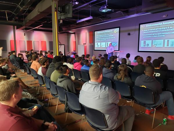 Students listen to the presentation given by Commander Pablo Breuer, USN, of the United States Special Operations Command Donovan Group, during the November event.