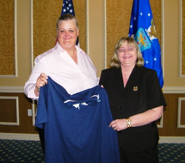 Chapter Vice President ý Industry, Melissa Errett (left), presents Ms Carpenter with a Chapter Polo ShirtTIDEWATER—Melissa Errett (l), chapter vice president, industry, presents Becky Carpenter, the July luncheon speaker, with a chapter polo shirt.