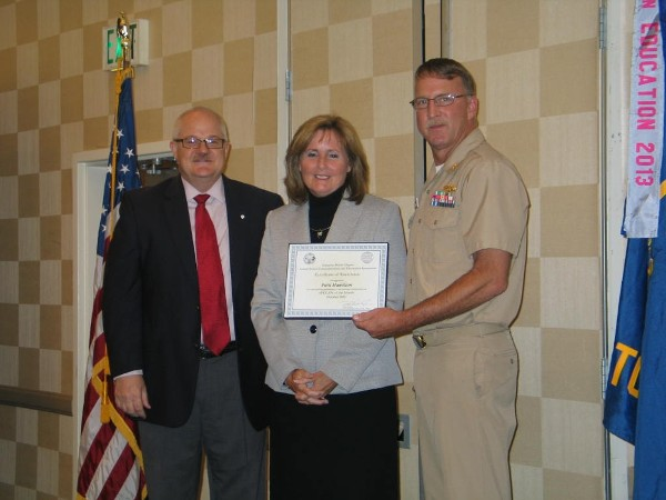 Lt. Cmdr. Doug Vanderlip, USN (r), chapter president, and Steve Frazier present the Civilian AFCEAN of the Month Award for October to Patti Hamilton, president of Hamilton Consulting Solutions Corp.
