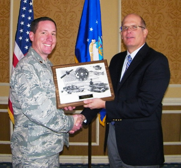 At the November luncheon, Hirlinger (r) recognizes Maj. Mike Zink, USAF, Air Combat Command/A6C, for his selection as the chapter's AFCEAN of the Month.