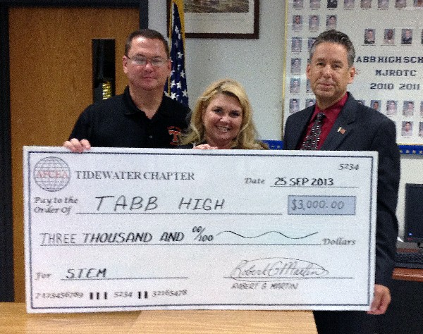 In November, Ed Crosby (r) of BAH presents Tabb High School's Cyber Patriot Team Commander Gary Wooten (l) and Principal Angela Seiders with a $3,000 AFCEA sponsored grant.
