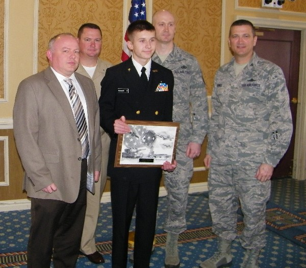 During the chapter's January luncheon, Bryan Dunsmore (c) displays his AFCEAN of the Month plaque along with (l-r) Tom Harris, DRC; Cmdr. Gary Wooten, Tabb High School Junior ROTC; Master Sgt. Matthew Dunsmore, USAF, Bryan's father; and Col. Powell.
