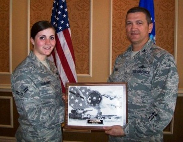 Col. Powell presents the March AFCEAN of the Month Award to Airman 1st Class Kylie Subjinske, USAF, Air Combat Command Computer Support Squadron, who distinguished herself by providing outstanding support during the Christopher Newport University Cyber Symposium.